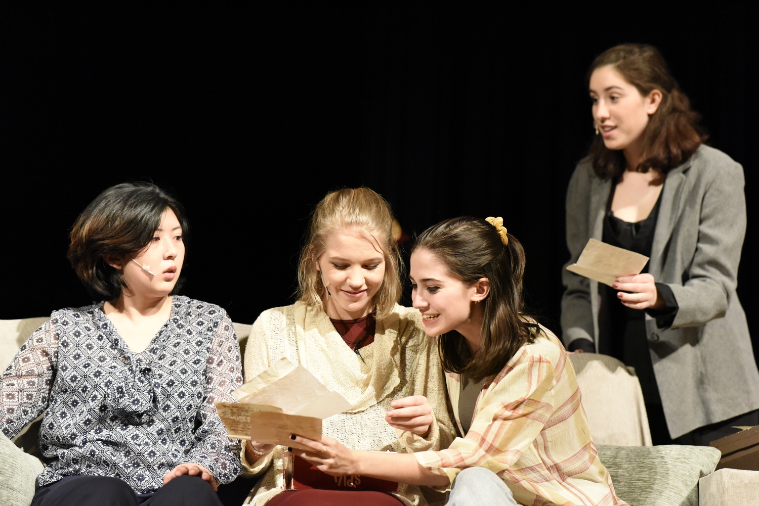 Sala, played by Jing Mae Wang '20, shows her family (left to right: Candace McQuaig '20, Caroline Gallagher '19, and Ava Vercesi '19) her old letters.
