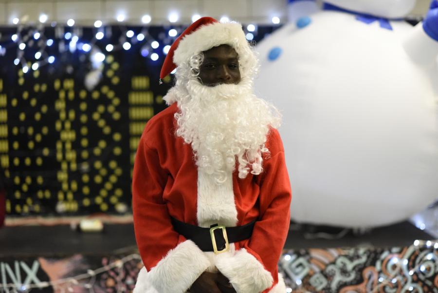Baboucarr Gaye '20 dresses as Santa Claus for the Winter Wonderland.
