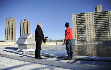 Assistant Principal Mr. Kalin (left) and Archit Kothari '19 (right) discuss the solar energy benefits of the 146 solar panels on Bronx Science's roof.
