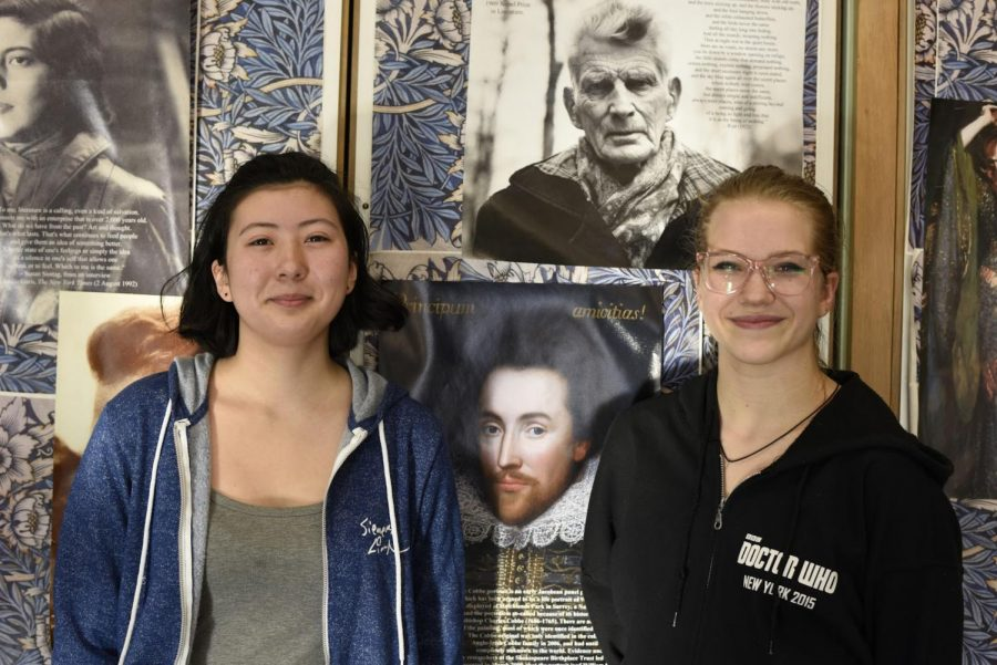 Jing Mae Wang '20 (winner, on left) and Sepncer McQuaig '20 (runner up, on right), stand in front of a print of the newly discovered Cobbe portrait of William Shakespeare.