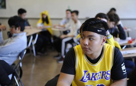 On Halloween, Alexander Basquial '20 attends class in Laker's Forward LeBron James' uniform.