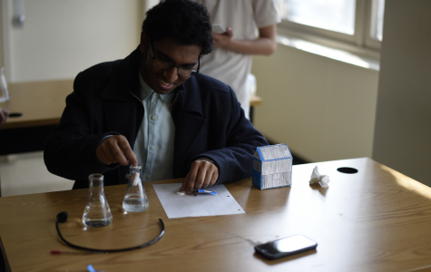 Dion Sukhram '19 puts together a device where alka-seltzer would be used to push a golf ball off a ramp for the event Mission Possible.