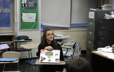 Chloe Frajmund, secretary of the National Women's Organization Club (N.O.W.), sits for a club discussion.