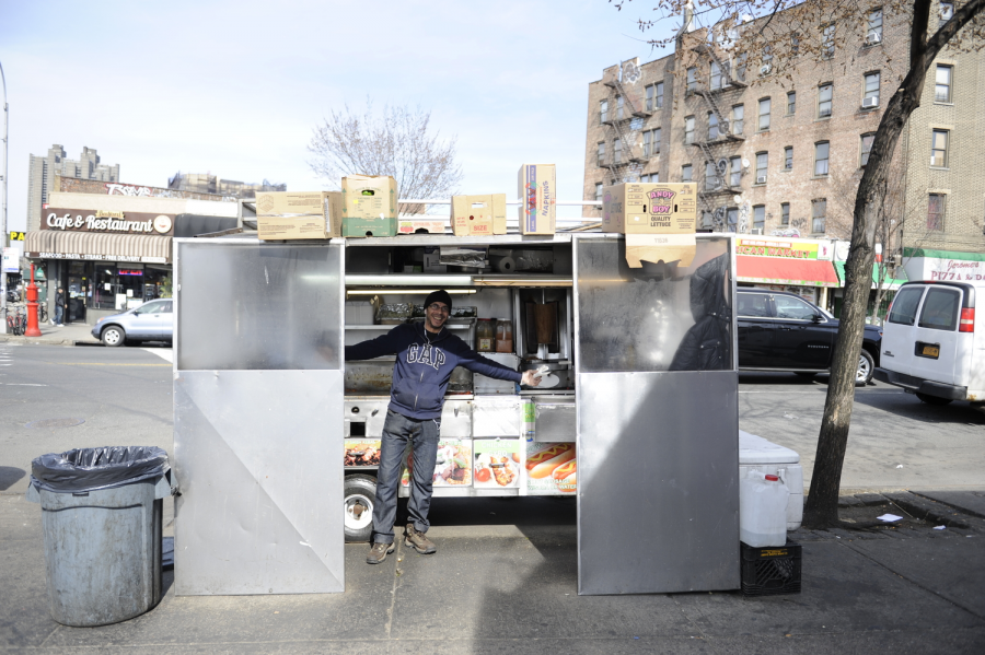 Chef Ali Gamil stands in front of Jerome's halal cart, which has been at the corner of Bedford Park Boulevard West and Jerome Avenue for the past eight years.