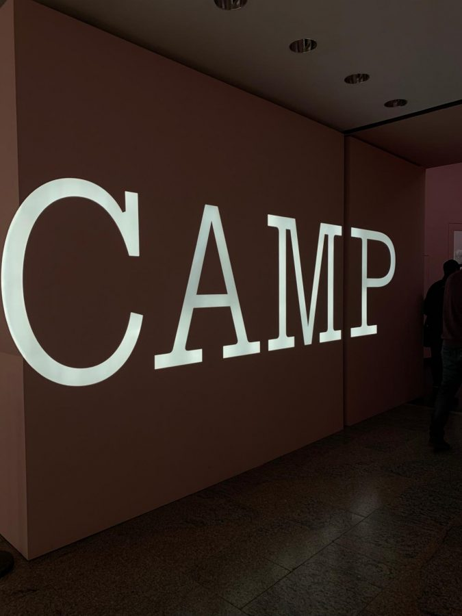 The Metropolitan Museum exhibit entrance welcomes visitors to 'Camp..'