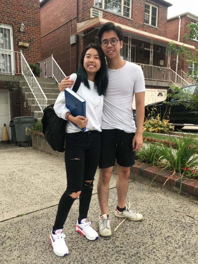 Megan and Kevin Ngo pose outside of their house in the Bronx.
