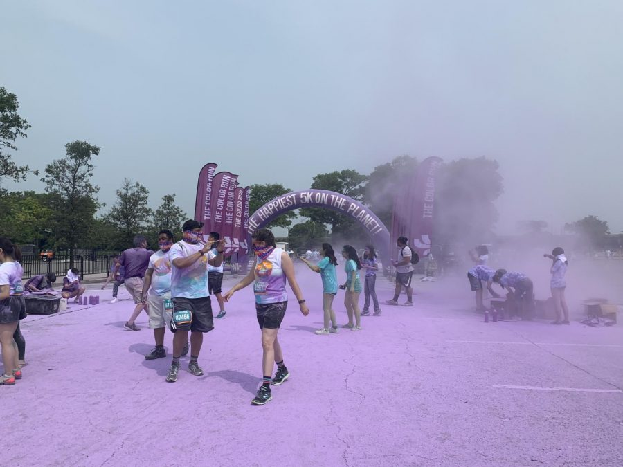 At the purple station, volunteers threw purple powder at the runners as they ran past.
