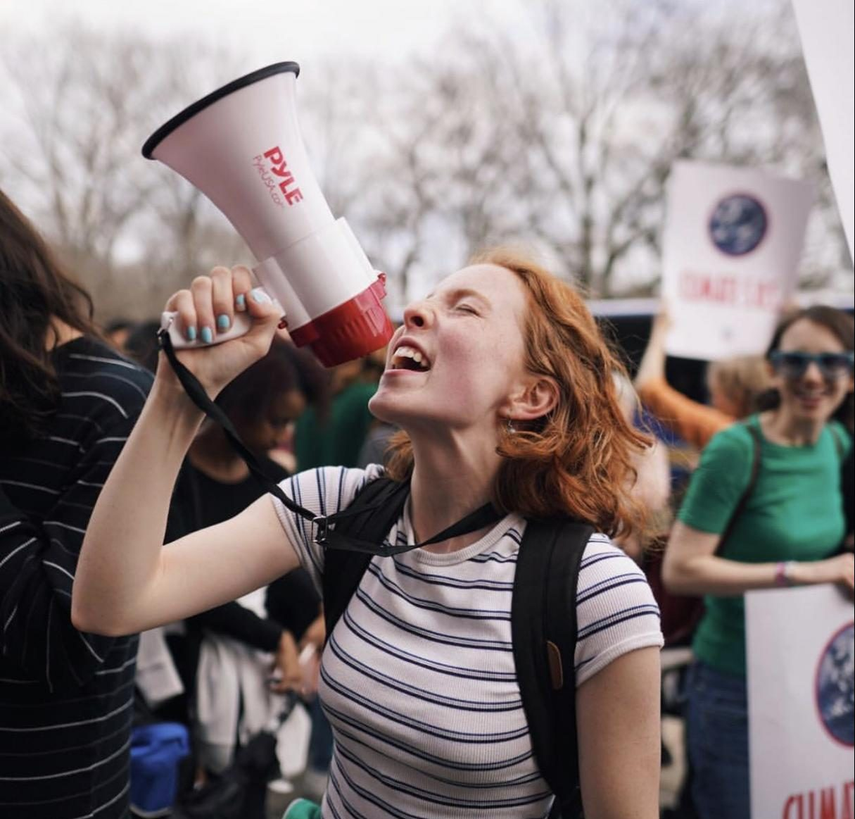 Climate activist and Bronx Science student Azalea Danes '20 chants passionately into a megaphone during the March 15th, 2019 climate strike at Columbus Circle.