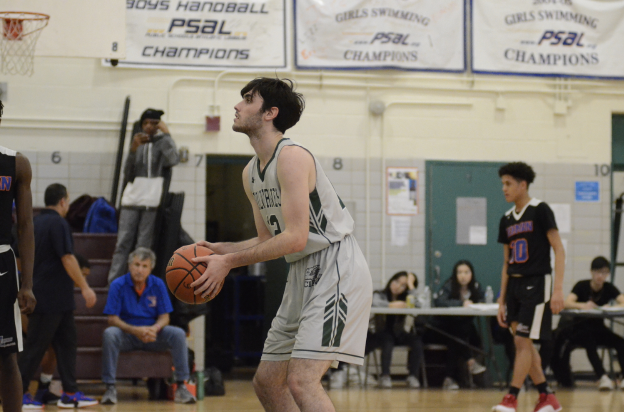 Jake Goldsmith '19, Varsity Basketball Star and diehard Knicks Fan, shoots a freethrow in a game in late December 2018.
