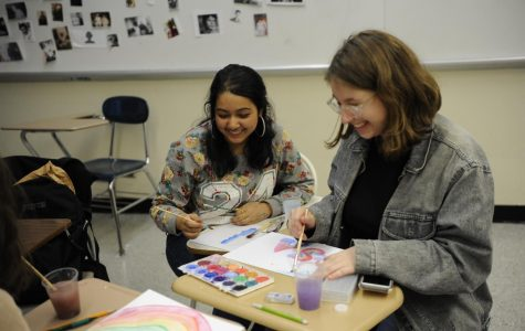 Eshika Talukder '20 and Stephanie Gallent '20 have fun painting posters for GSA.