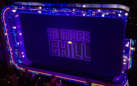 "The 'Be More Chill' musical displays this screen covering before the start of the show and also during intermission. However, the pill on the ""i"" is gray at first and changes to yellow during the intermission, indicating the activation of the ""SQUIP"""