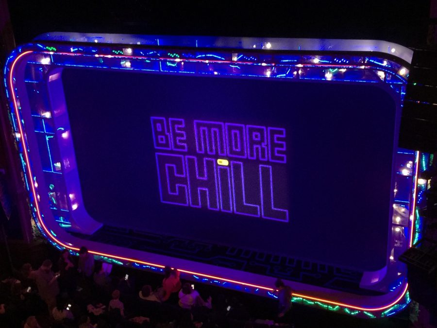 """The Be More Chill musical displays this screen covering before the start of the play and during intermission. However, the pill on the """"i"""" is gray at first and changes to yellow during the intermission, indicating the activation of the """"SQUIP"""""""