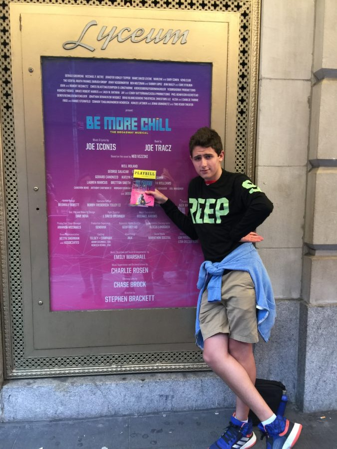 Griffin Dugger-Ades '23 dons his CREEPS shirt from the Be More Chill Musical in front of the Lyceum Theatre Entrance