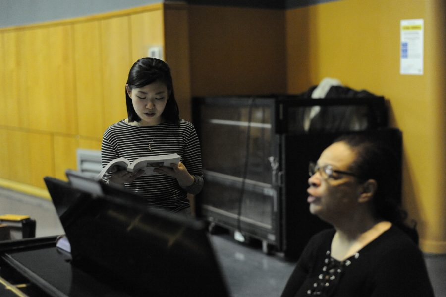 In rehearsal, Victoria Ono '19 works with the musical director on the opening number for her role as the understudy for the Baker's Wife.