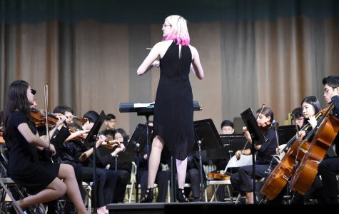 """I think of conducting as being the vessel through which the orchestra understands the music. To me, it just seemed like a more in-depth way to appreciate the music I had already devoted myself to,"" said Amelia Krinke '23, who arranged and conducted a piece for the Orchestra."