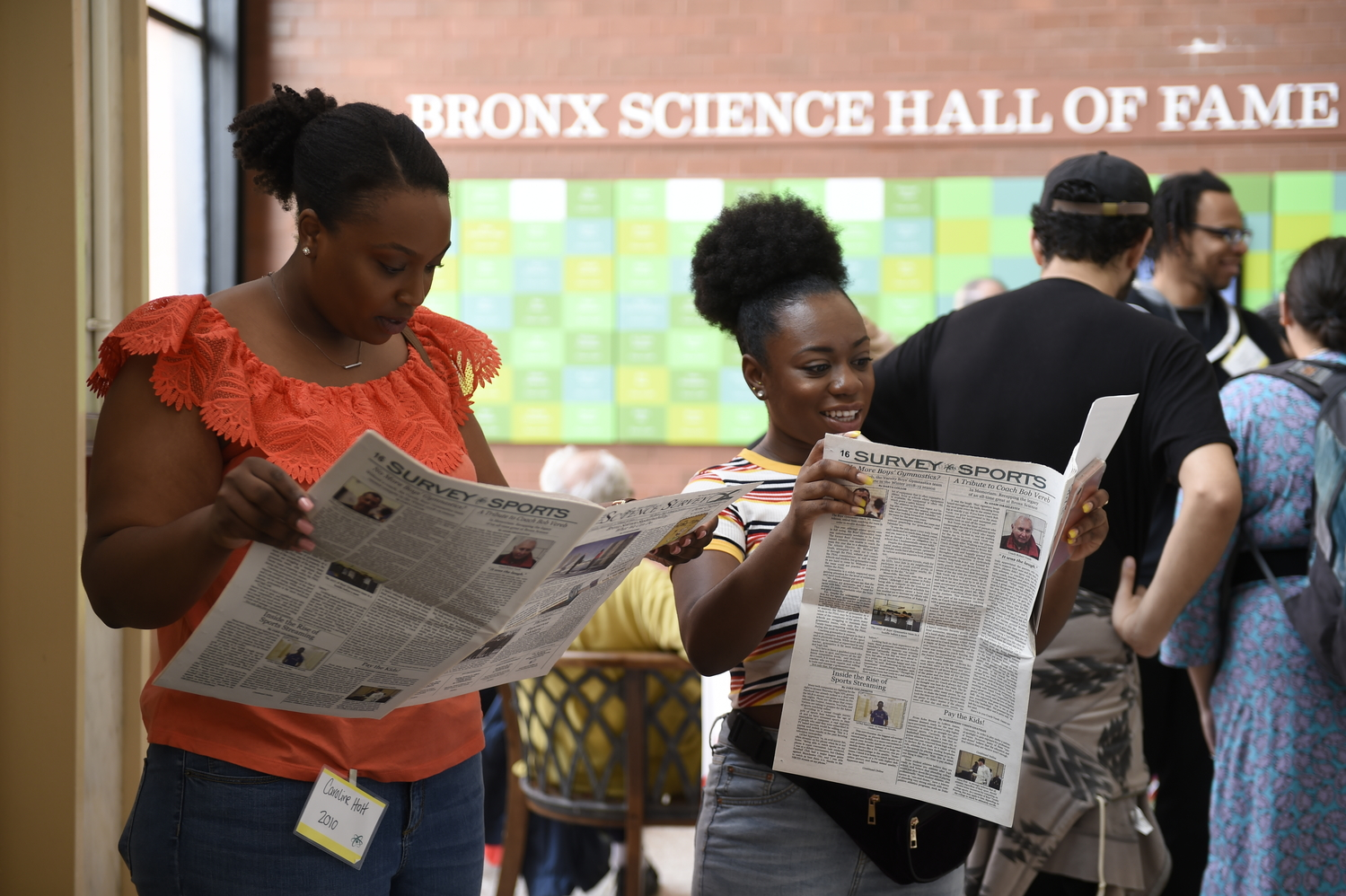 Caroline Holt '10 and Katherina Brown '10 read the latest issue of 'The Science Survey' during Alumni Day on June 2nd, 2019.