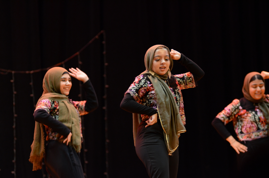 Momina Begum '19, Naima Nadia '19  and   Fatema Kamal '19 show off their dance during the Nasha Show.