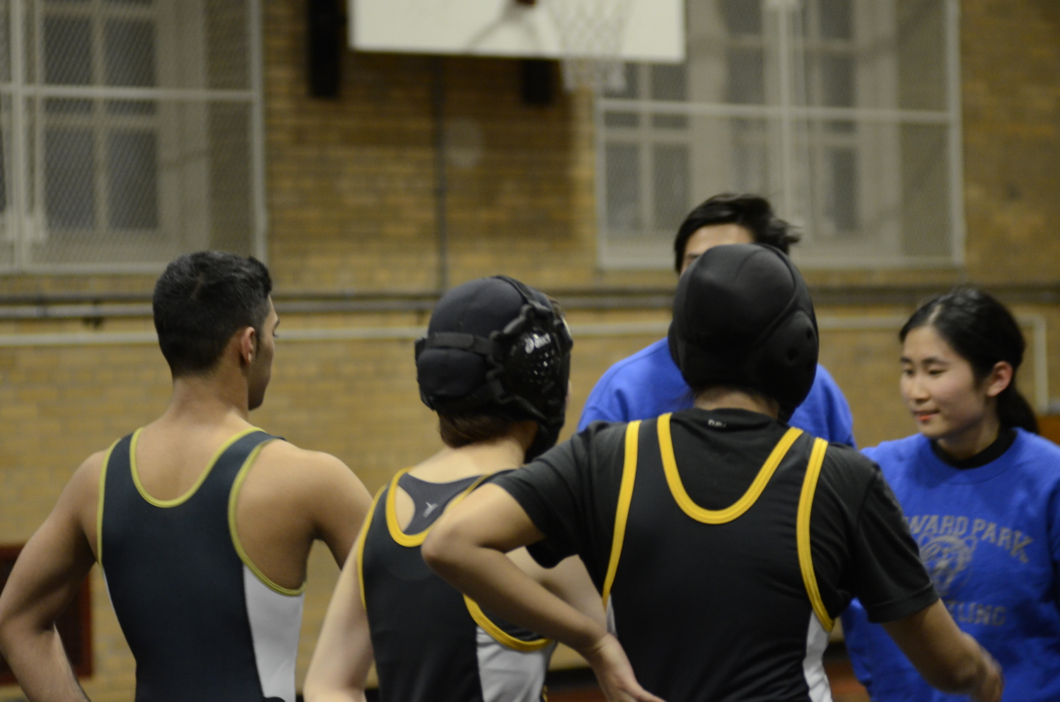 A view of the skull caps on co-ed wrestling captains Lyn Kajihara '19 and Zainab Mridha '19.