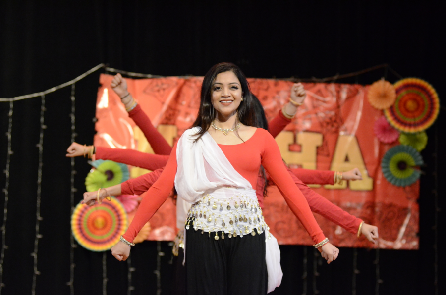 Eshani Chowdhury '19 helps to lead her group for their NASHA performance.