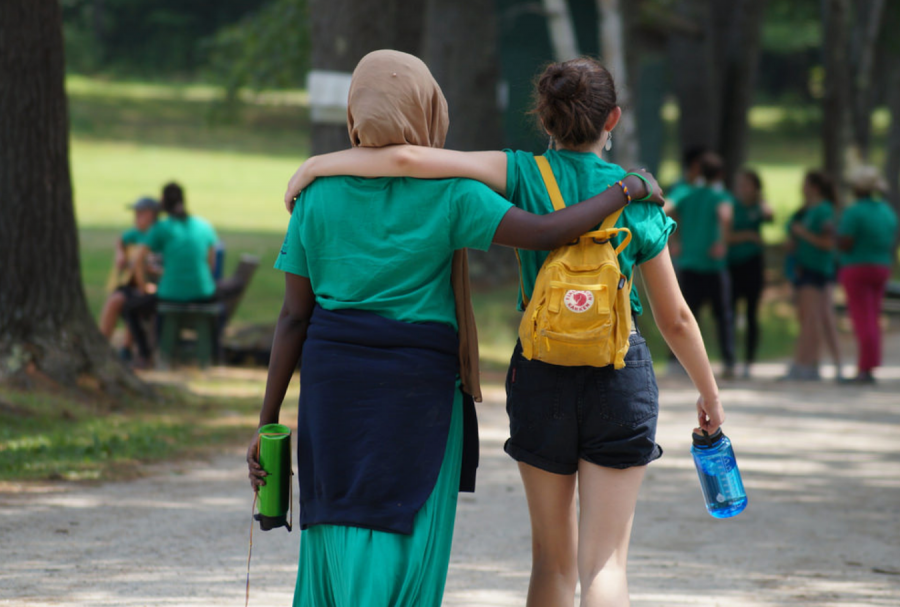 Edie Fine '21 walks alongside a fellow seed during Seeds of Peace during summer 2018.