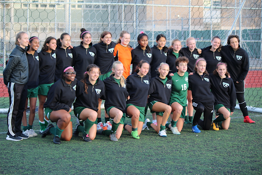 Bronx Science Girls Varsity Soccer team posing for a team photo after one of their many practices.
