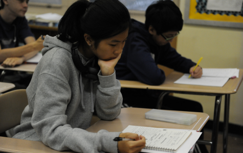 Blanche Lin '22 finishes her classwork in her Algebra 2 class.