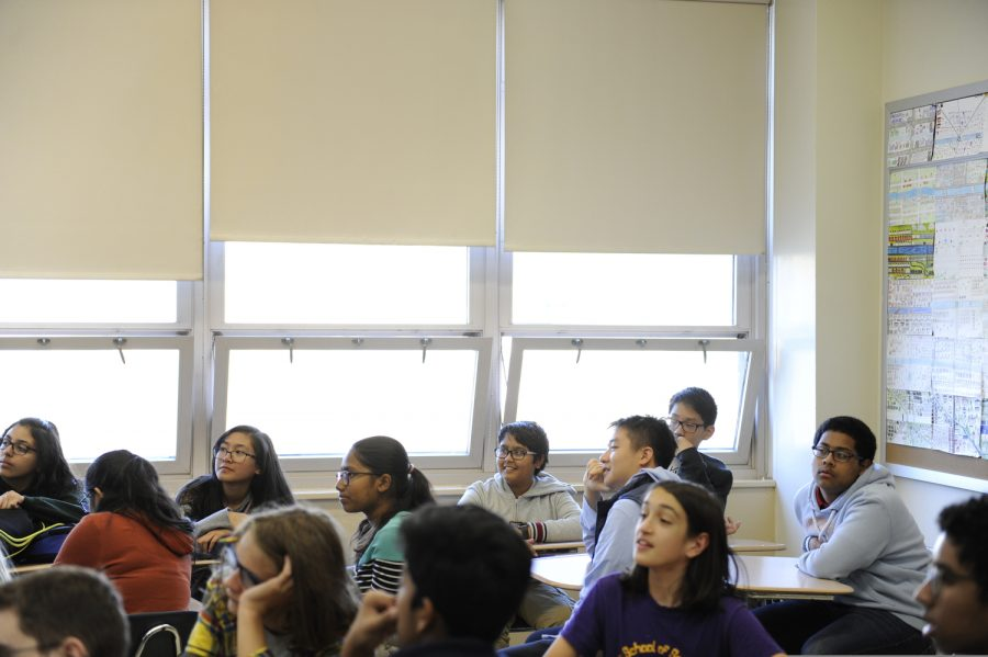 Students in a ninth grade homeroom pay close attention to a presentation during after-school guidance. Through this program, the new students learn valuable insight about Bronx Science from current seniors.
