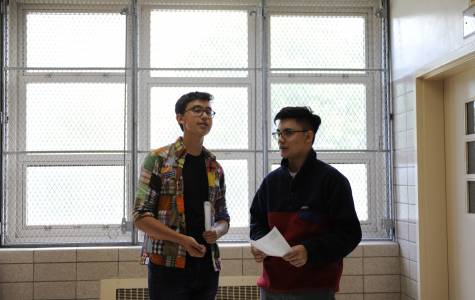 Jonathan Bar-On '20 and Garreth Hui '20 discussing the current famine in North Korea and potential resolutions.