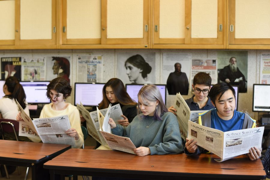 Journalism students proof the most recent issue of 'The Science Survey.'