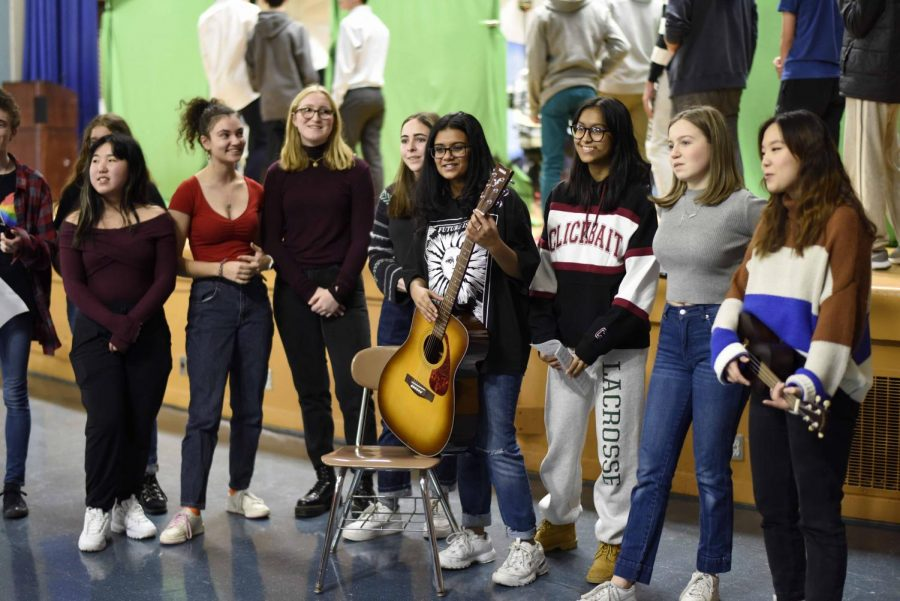 Carolers from Bronx Science's Chorus spread the holiday spirit by performing festive songs for their peers.