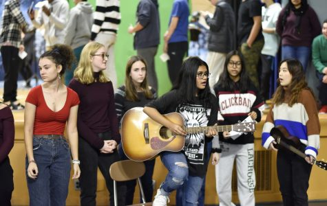Students in chorus sing Auld Lang Syne during visits to classrooms before the Winter Break.