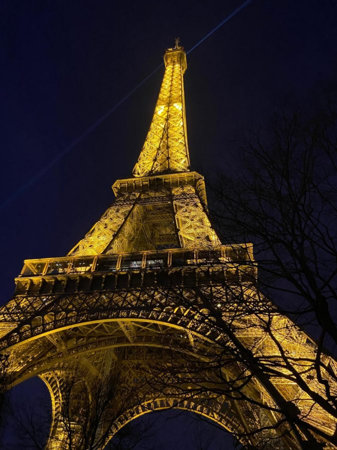 The+glowing%2C+lit-up+Eiffel+Tower+stands+in+front+of+a+midnight+blue+sky.+Sophie+Poritzky+%E2%80%9921+loves+taking+pictures+from+unconventional+perspectives.+She+says%2C+%E2%80%9CI+love+how+photography+can+capture+a+really+special+moment+and+keep+it+forever%2C+both+physically+and+in+my+memory.%E2%80%9D