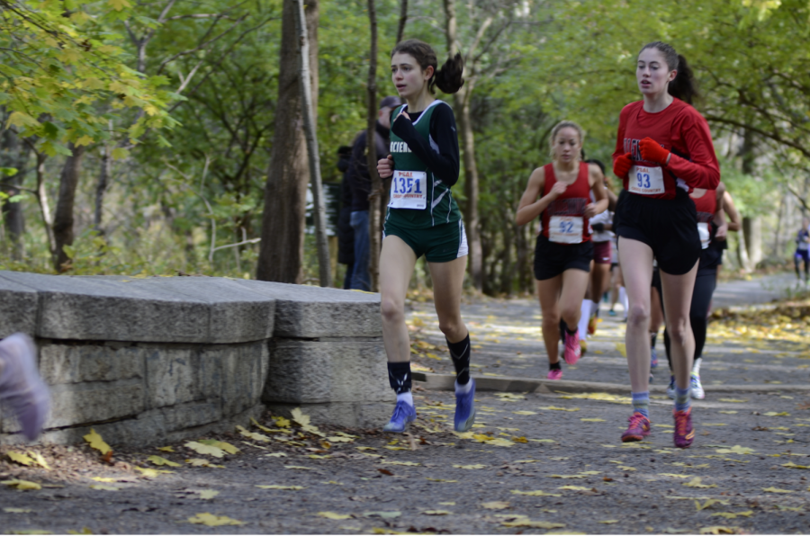 "Cross country and track athlete Zoe Cooper '20 runs a cross country race through Van Cortlandt Park. ""If I'm pushing myself in our practices, that gives me the physical strength to perform well at meets,"" said Cooper."