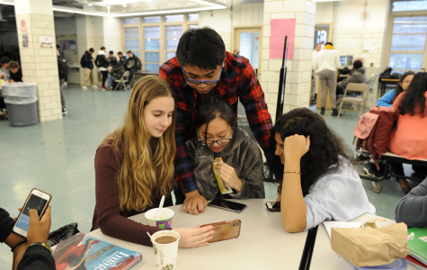 Students gather around the lunch table, scrolling through TikTok, a popular app among Generation Z students.