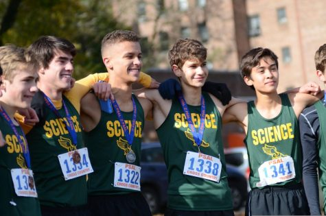 "The varsity team lines up with their medals after claiming the PSAL championship title. ""We knew we could win if we ran well, and we didn't want to let ourselves down,"" said Wyatt Morgan '20."