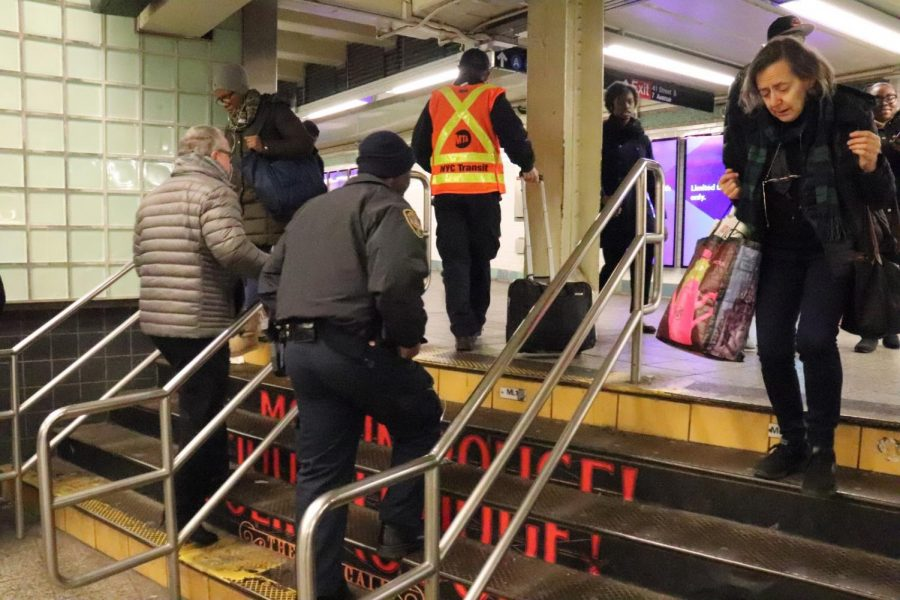 A+police+officer+walks+up+the+steps+of+the+Times+Square+subway+station+in+accordance+with+Governor+Cuomo%E2%80%99s+policy.