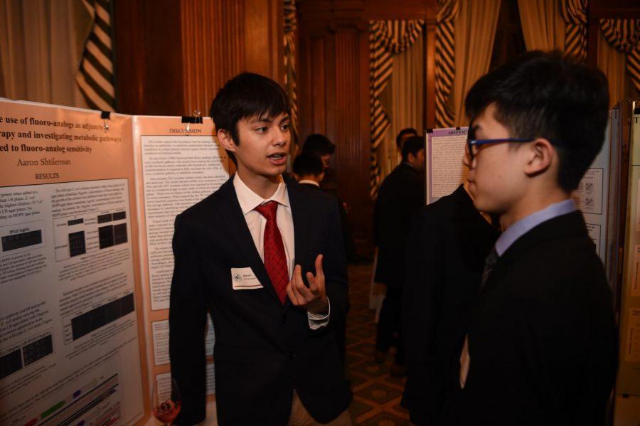 Aaron Shtilerman '20 enthusiastically describes his research to his fellow classmate.