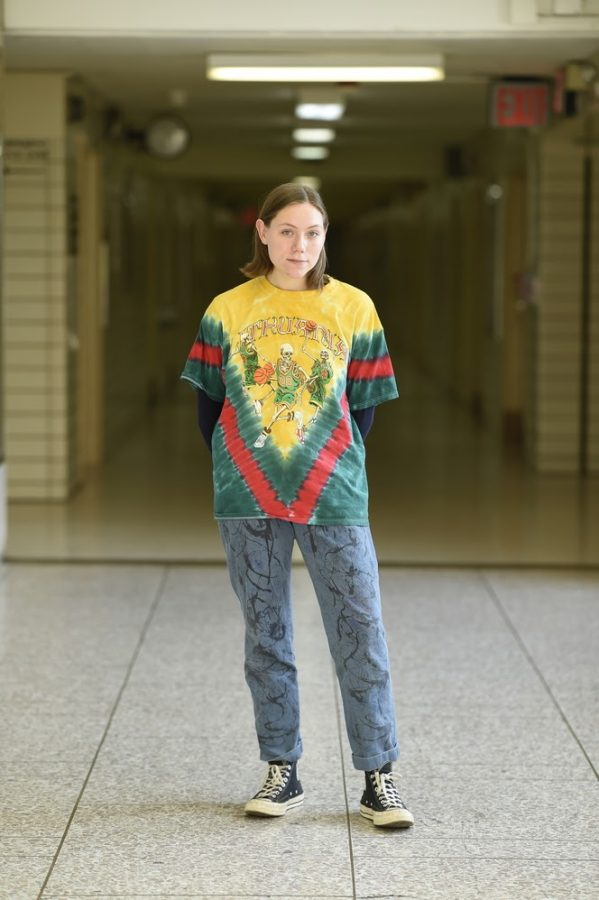 """Ula Pranevicius '20 wears a Lithuanian basketball shirt, which features the word """"Lithuania"""" written across the top and skeletons playing basketball."""