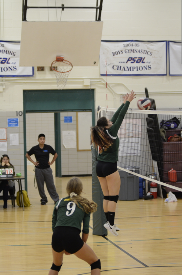 "Josephine Kinlan '22 scores another point, powering the ball right over the net. ""You feel elated and like your hard work paid off when you score a point for your team,"" said Kinlan."