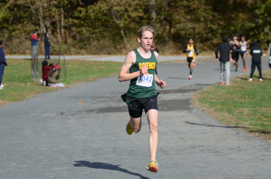 Itamar Pres '21 runs along the Van Cortlandt 5K course at the city finals. He will lead the Wolverines as one of the team's top cross country runners next year.