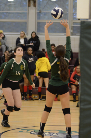 "As Jessica Muller '21 sets the volleyball high into the air, Carolina Hohl '22 prepares to aid her in bumping it over the net. ""I am ready for anything when I'm on the court,"" said Muller."