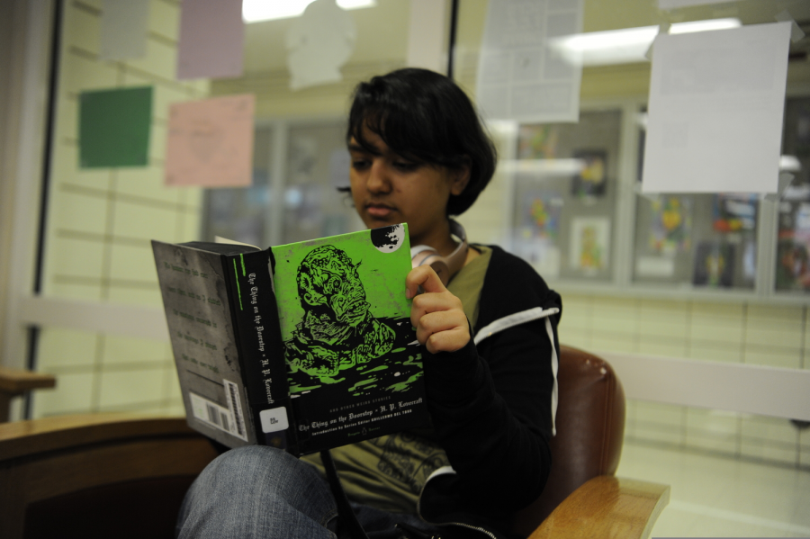 Subha Laskar '20 reads 'The Thing on the Doorstop' by H.P. Lovecraft, found in the Bronx Science library.