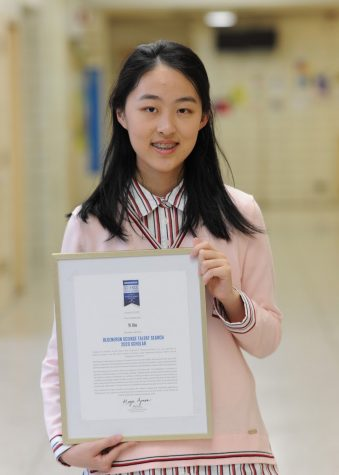 "Eva Xie '20 proudly shows her Regeneron Scholar Certificate. ""I joined the research program because I believed it would provide me with the chance to step into my dream career. Here in New York, merely embracing and pursuing any possibility can lead to breakthroughs,"" she said."