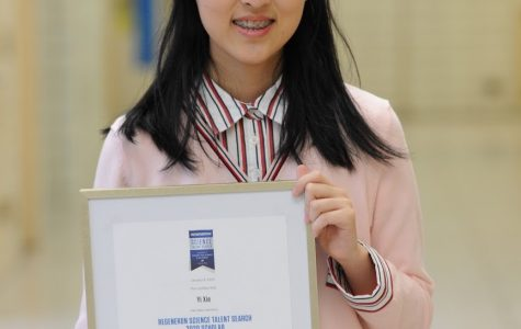 """Eva Xie '20 proudly shows her Regeneron Scholar Certificate. """"I joined the research program because I believed it would provide me with the chance to step into my dream career. Here in New York, merely embracing and pursuing any possibility can lead to breakthroughs,"""" she said."""
