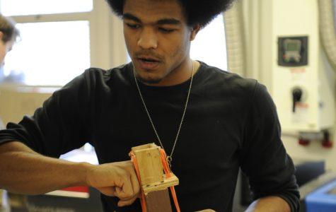 Kiyro Flamer-Caldera '20 puts the finishing touches on his engineering project.