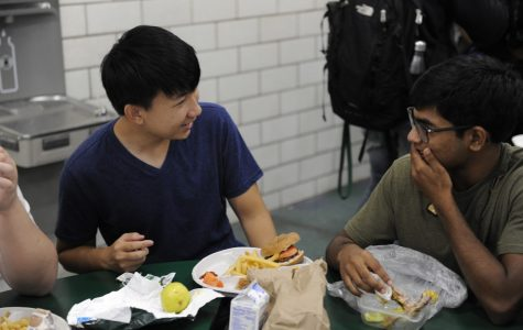 Students enjoy a delicious and healthy lunch in the Bronx Science cafeteria, thanks to the hard work and dedication of the cafeteria workers.