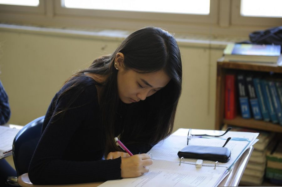 A student is immersed in class work.