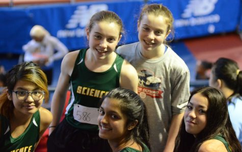 "Ninth graders smile for the camera at the annual Martin Luther King track meet. ""I enjoyed the moments that we had at the armory which contrasted with cross country,"" said Chloe Chan '23 who ran the 600m and 3000m in indoor track."
