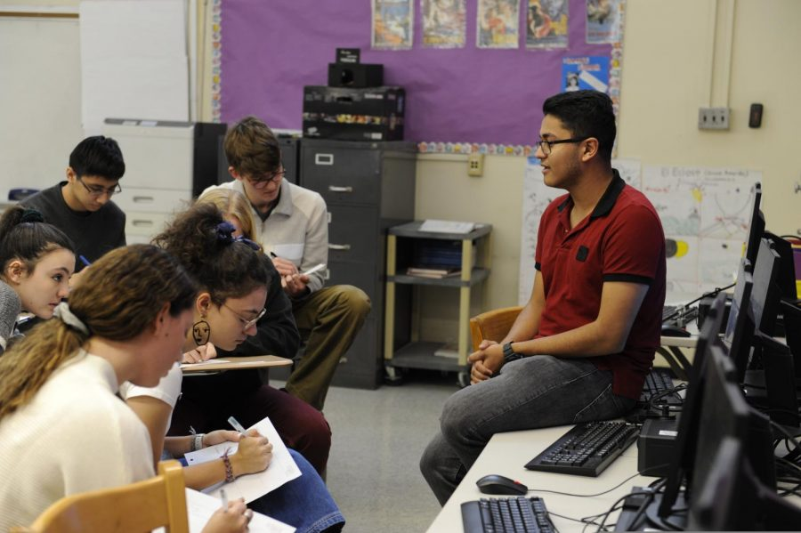 Ayanava Ganguly '21 presents to his classmates in Spanish for Professions.