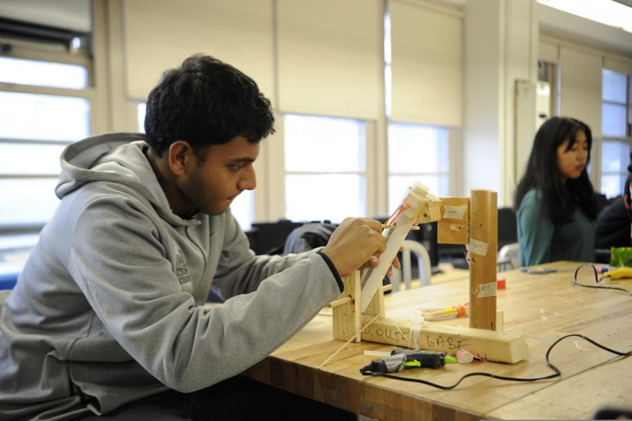 A senior is focused on his project for Experimental Engineering.